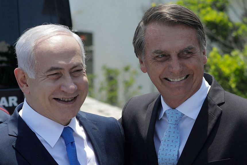 Netanyahu (left) is welcomed by Bolsonaro at the Copacabana fort in Rio de Janeiro, Brazil.