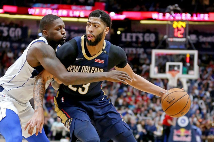 New Orleans Pelicans forward Anthony Davis (right) is defended by Dallas Mavericks forward Dorian Finney-Smith in the second half at the Smoothie King Center on Dec 28, 2018.
