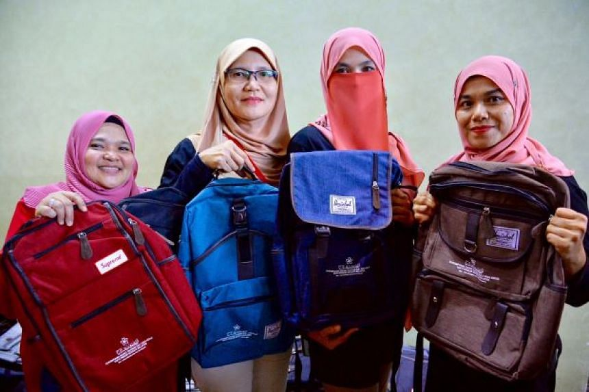 A logo of the party is emblazoned on the Herschel backpacks, which cost about RM300 (S$99) each.