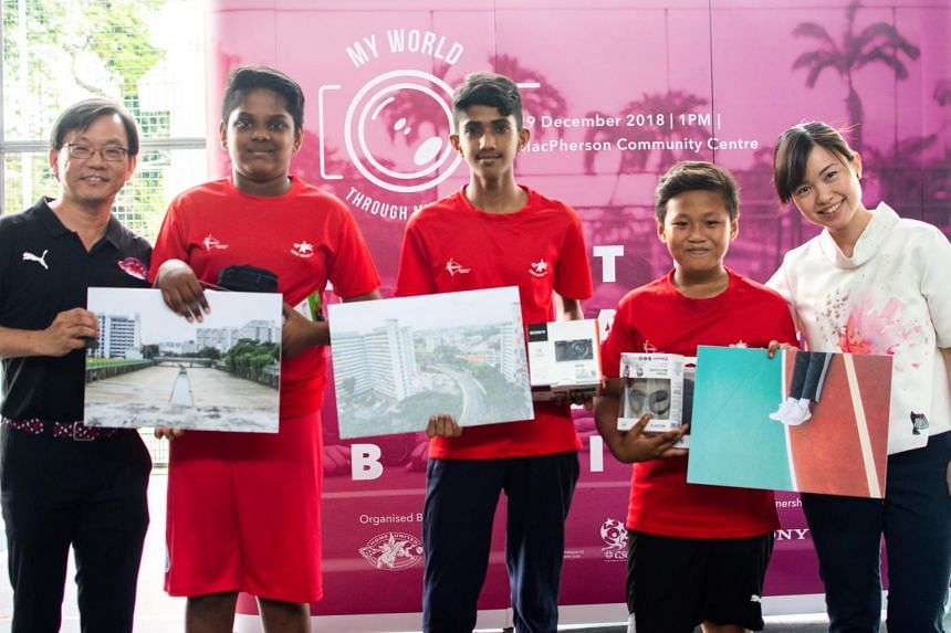 MacPherson SMC MP Tin Pei Ling and Bishan-Toa Payoh GRC MP Chong Kee Hiong with prize-winning youths from the MacPherson Teen Network Club at a photography exhibition organised by Home United.