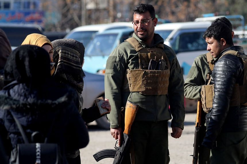 Armed men guard the streets in the northern Syrian town of Manbij.