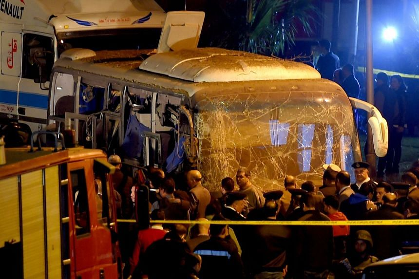 Officials at the scene of the attack on a tourist bus in Giza.
