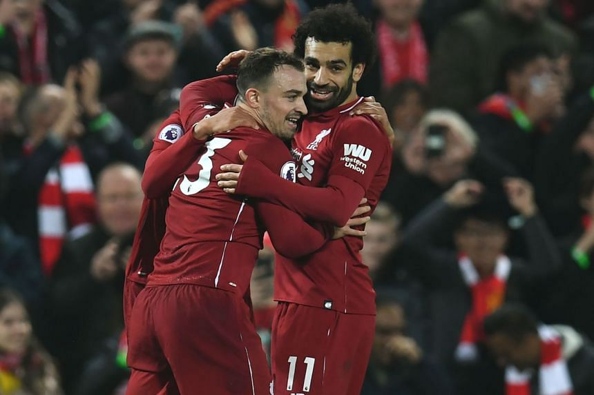 Liverpool's Swiss midfielder Xherdan Shaqiri (centre) celebrates with Liverpool's Egyptian midfielder Mohamed Salah (right) and teammates during the English Premier League football match between Liverpool and Newcastle United, on Dec 26, 2018.