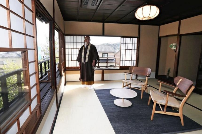 A monk stands in a room at the Shorinan lodgings prepared to accommodate wealthy visitors staying overnight at Ninnaji temple in Kyoto.