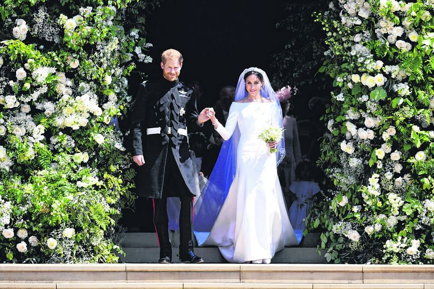 Prince Harry and American actress Meghan Markle leaving St George's Chapel at Windsor Castle after their wedding in May. The wedding was not without controversy, after Ms Markle's siblings cast aspersions on her motives. Her father also staged a papa