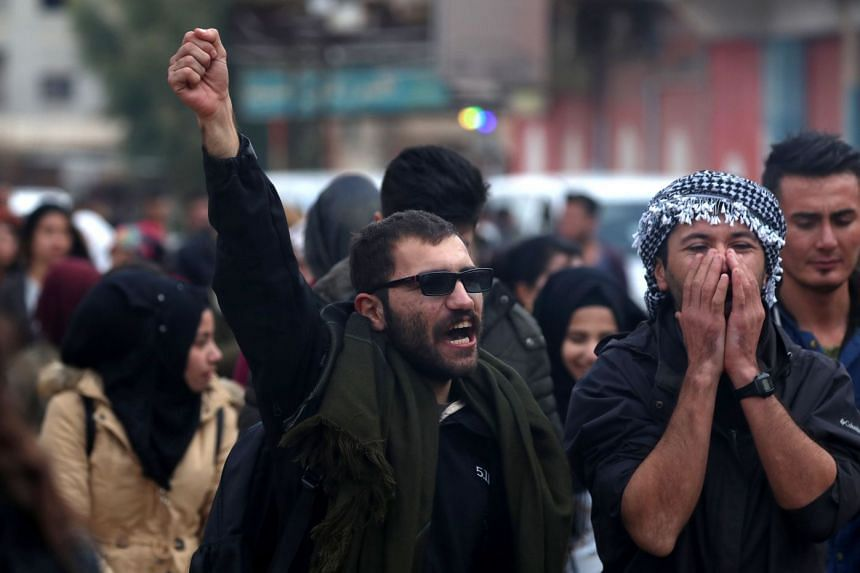 Syrian Kurds take part in a demonstration in the northeastern Syrian Kurdish-majority city of Qamishli on Dec 28, 2018, against threats from Turkey to carry out a fresh offensive following the US decision to withdraw their troops.