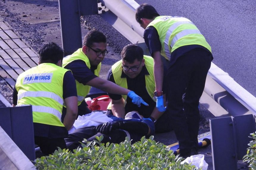 Paramedics attending to the motorcyclist, who was subsequently taken to Tan Tock Seng Hospital.