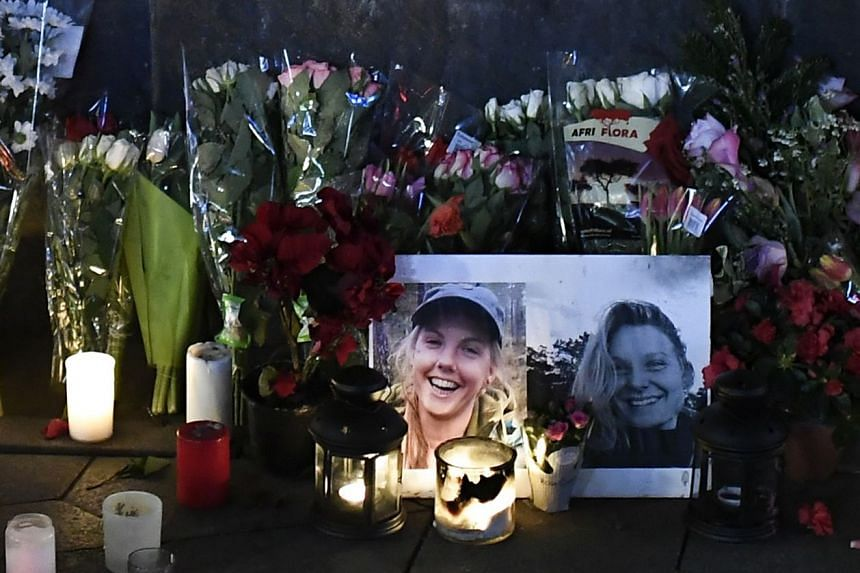 A makeshift memorial featuring photos of the two victims is seen in Copenhagen.