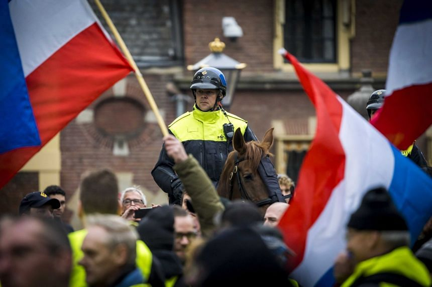 Protestors wearing yellow vests demonstrate in The Hague, The Netherlands, Dec 29, 2018.