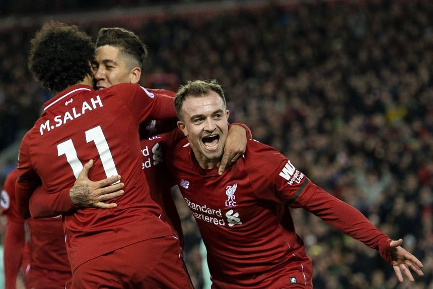 Liverpool's Roberto Firmino is congratulated by Mohamed Salah and Xherdan Shaqiri (right) after scoring.