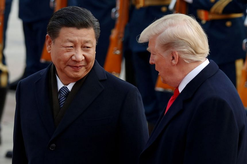 US President Donald Trump is welcomed by China's President Xi Jinping in Beijing in 2017.