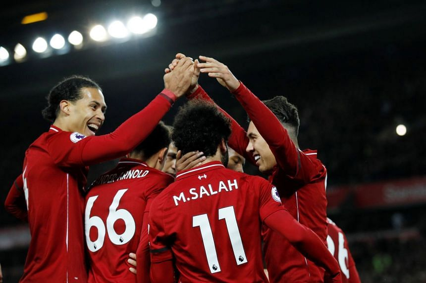 Liverpool's Roberto Firmino celebrates scoring their fifth goal with Virgil van Dijk and teammates.