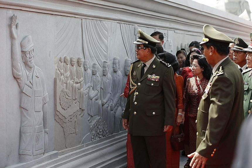 Cambodia's Prime Minister Hun Sen at the inauguration in Phnom Penh yesterday of a monument showcasing his government's achievements. He vowed to use all means to protect the country's hard-earned peace as it marked the 20th anniversary of the end of