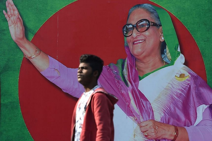 A campaign poster featuring Bangladeshi Prime Minister Sheikh Hasina, who is seeking a record fourth term in today's polls.
