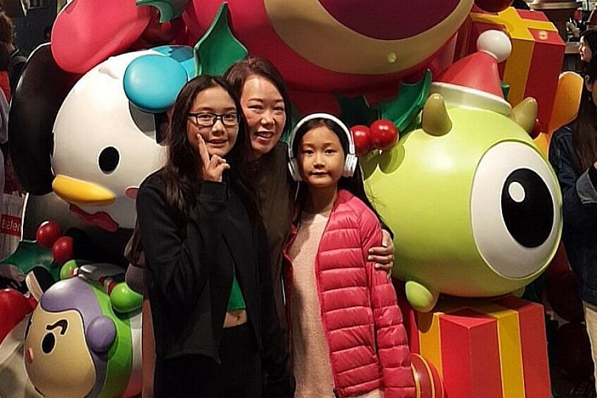 Ms Irene Woo and her daughters, Eneri (left), 10, and Reine, eight, at a mall in Hong Kong. They left for Hong Kong last Friday for a five-day break. The beach view at the Club Med Phuket resort (top) and at the Club Med Bali resort (above). Travelli