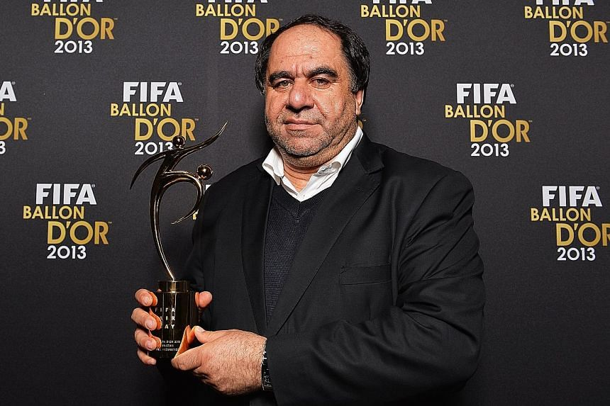 Afghanistan Football Federation boss Keramuddin Karim with the Fifa Fair Play Award after the Ballon d'Or Gala 2013 at the Kongresshaus in January 2014 in Zurich, Switzerland.
