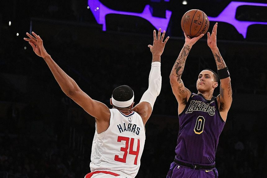 Los Angeles Lakers forward Kyle Kuzma attempting a shot over LA Clippers forward Tobias Harris in the game between the in-town rivals at Staples Centre on Friday night. Despite the Lakers enjoying a double-digit lead, the Clippers went on a 22-0 run