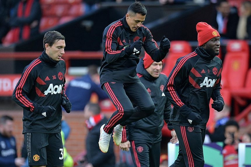 Alexis Sanchez and Romelu Lukaku warming up before a United game. Injuries and form have restricted their appearances this season but caretaker manager Ole Gunnar Solskjaer says they need to be self-motivated and emulate Paul Pogba by proving their w
