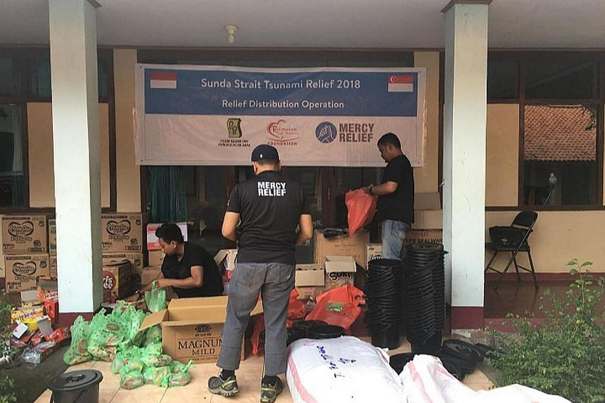 Singapore's humanitarian aid group Mercy Relief providing help in areas hit by the tsunami. It plans to distribute water and other supplies to those affected by the disaster. The devastation caused by the Dec 22 tsunami in Sumur district, which was t