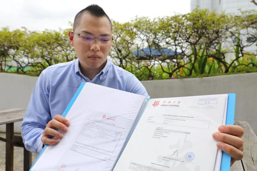 Mr Edwin Chaw with school certificates showing the contrast in his Secondary 4 and Junior College 1 grades. The IP student scored mostly As in Sec 4, but problems at home and bouts of anxiety affected his performance in JC1 and his grades plunged to