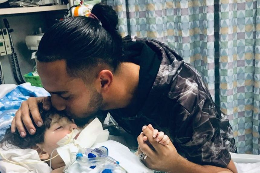 Abdullah on life-support at a hospital in California on Dec 16, 2018. with his father Ali.
