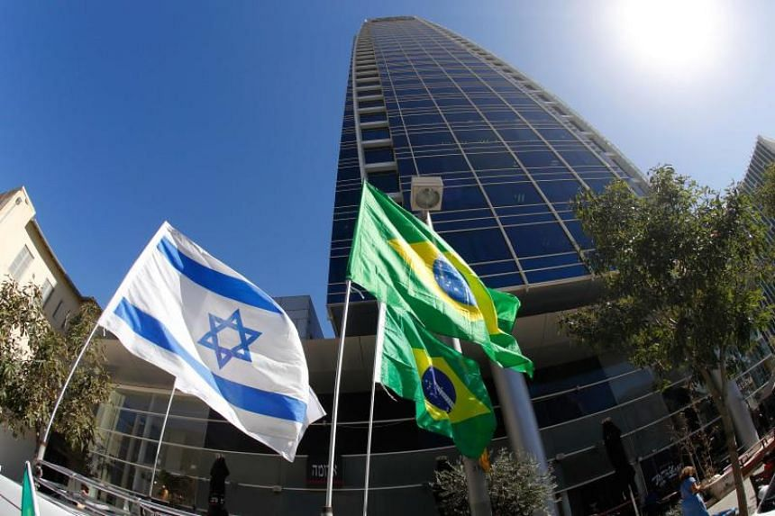 The Israeli and Brazilian flags hang outside the building housing the offices of the Brazilian Embassy, in the Israeli city of Tel Aviv.