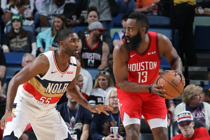 Houston Rockets guard James Harden (#13) preparing to drive against New Orleans Pelicans guard E'Twaun Moore (#55) during their NBA match on Dec 29, 2018.