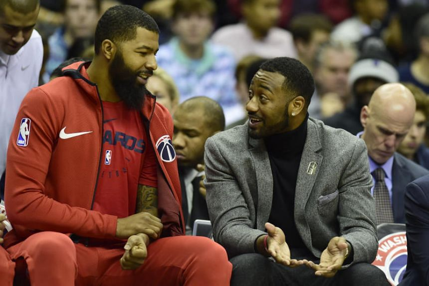 Washington WIzards guard John Wall (right) speaking with teammate Markieff Morris during the first quarter of the NBA game against the Chicago Bulls on Dec 28, 2018.