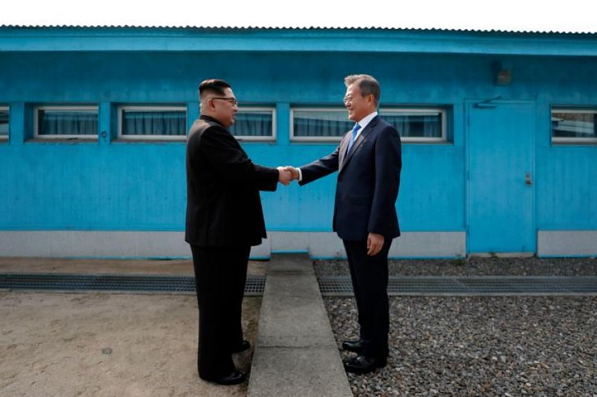 North Korean leader Kim Jong Un (left) meeting South Korean President Moon Jae-in at the Military Demarcation Line between the two countries in Panmunjom on April 27, 2018.