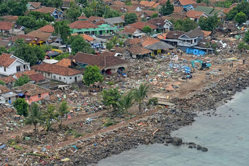 Damaged houses are seen at Way Muli village in Rajabasa, South Lampung in Indonesia, after it was hit by a tsunami, on Dec 25, 2018.