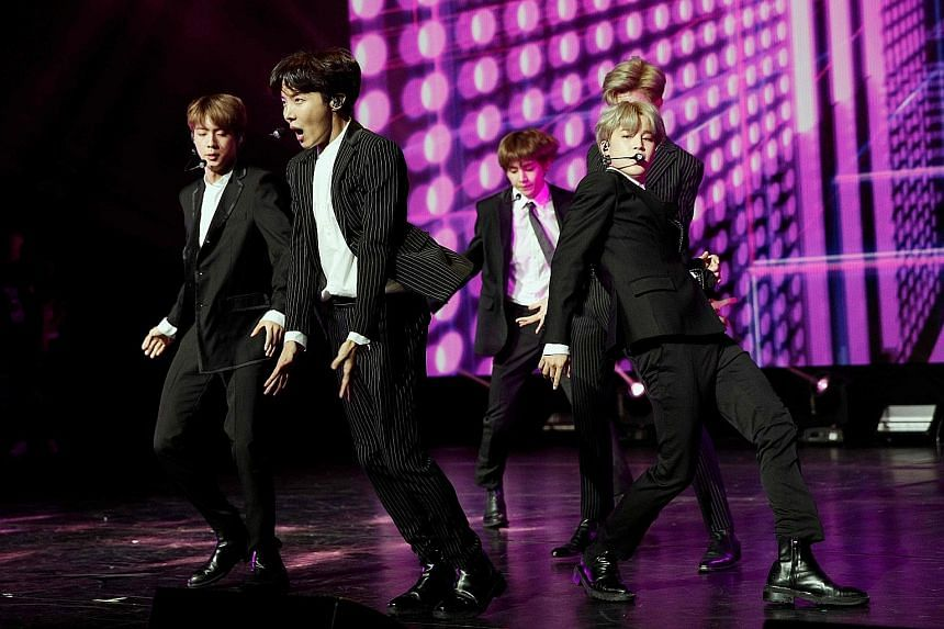 """An online boycott campaign launched against BTS (left) for promoting """"over-the-top immoral behaviour"""" led to the cancellation of the band's film, BTS World Tour: Love Yourself In Seoul."""