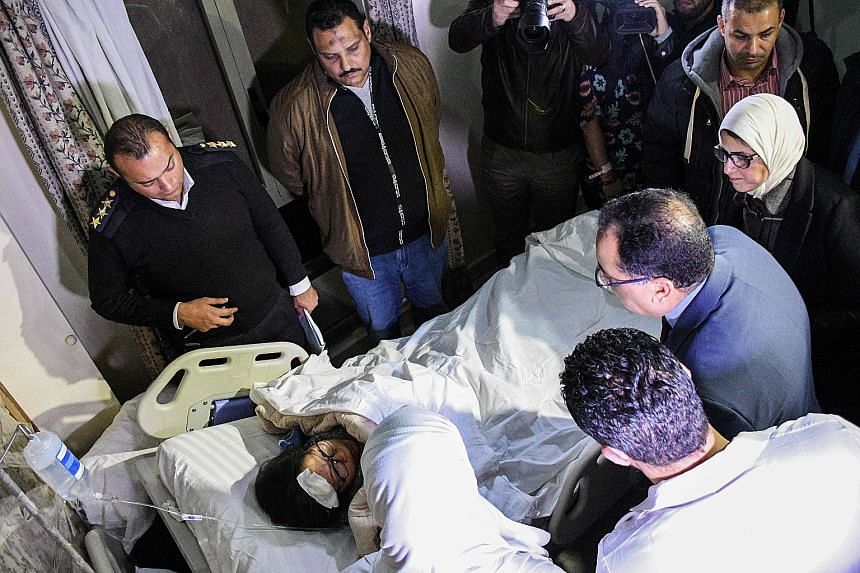 Egypt's Prime Minister Mostafa Madbouli (second from far right) visiting one of the victims of the tour bus attack at a hospital in Al-Haram district in Giza last Friday. The attack came as Egypt's tourism sector has begun to recover after years of i