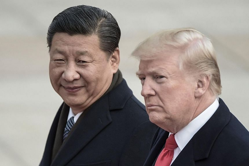 Chinese President Xi Jinping and US President Donald Trump in Beijing last year. Mr Xi said they hope to push for stable progress in US-China ties.