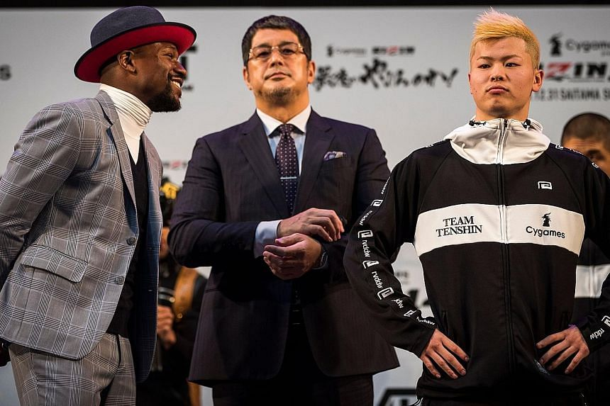 """Floyd Mayweather takes on Tenshin Nasukawa (right) today in a three-round exhibition, which the American said he could do """"in his sleep"""". The bout will not count on the official record of either athlete."""