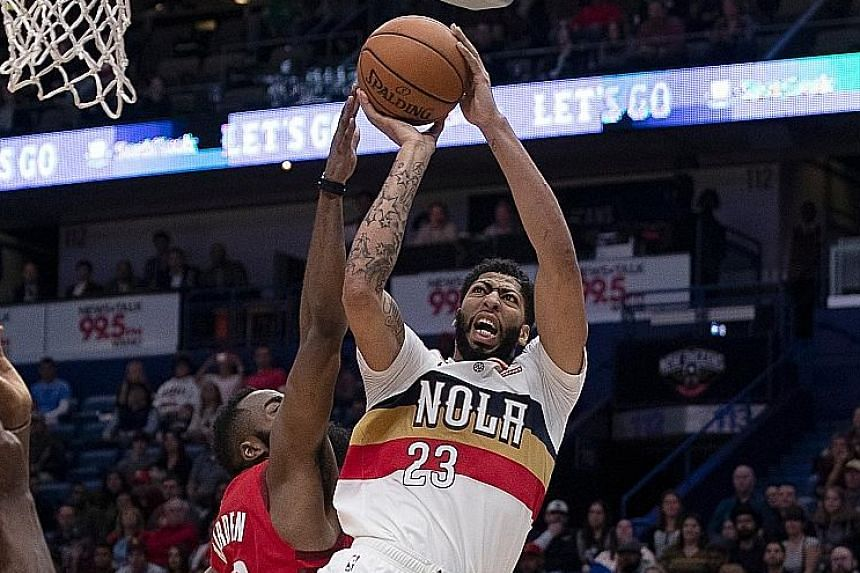Rockets guard James Harden (left) trying to deter Pelicans forward Anthony Davis in Houston's 108-104 victory over New Orleans on Saturday. But it was Harden's work on the offensive end that won the day, as the reigning Most Valuable Player scored 41