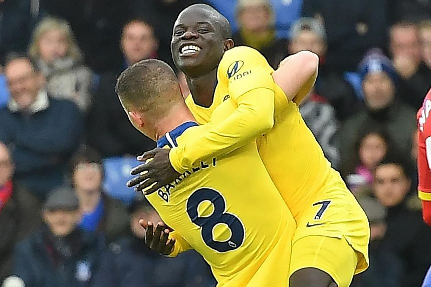 Chelsea's N'Golo Kante leaping into the arms of teammate Ross Barkley after scoring the only goal against Crystal Palace.