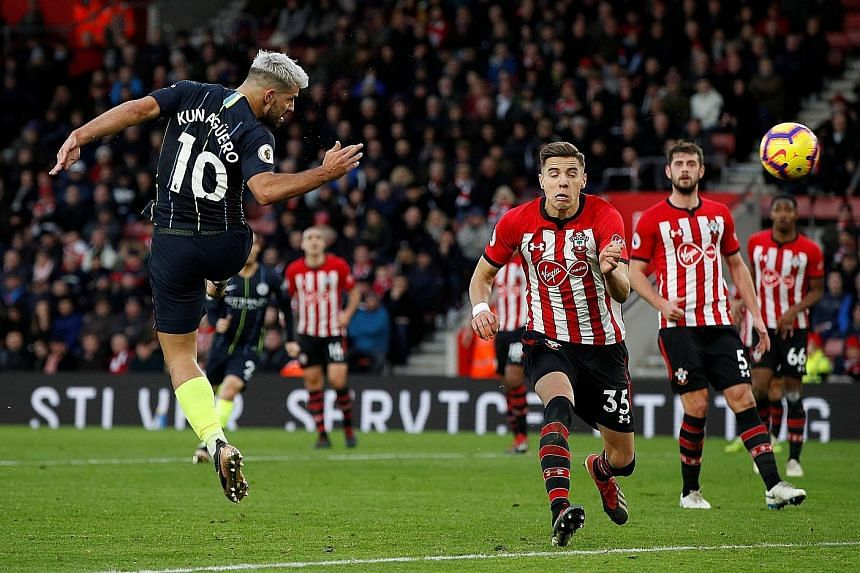 Sergio Aguero heads home Manchester City's third goal against Southampton just before half-time at St Mary's Stadium yesterday. The Argentinian's ninth league goal this season gave the champions a two-goal cushion, as Pep Guardiola's men returned to