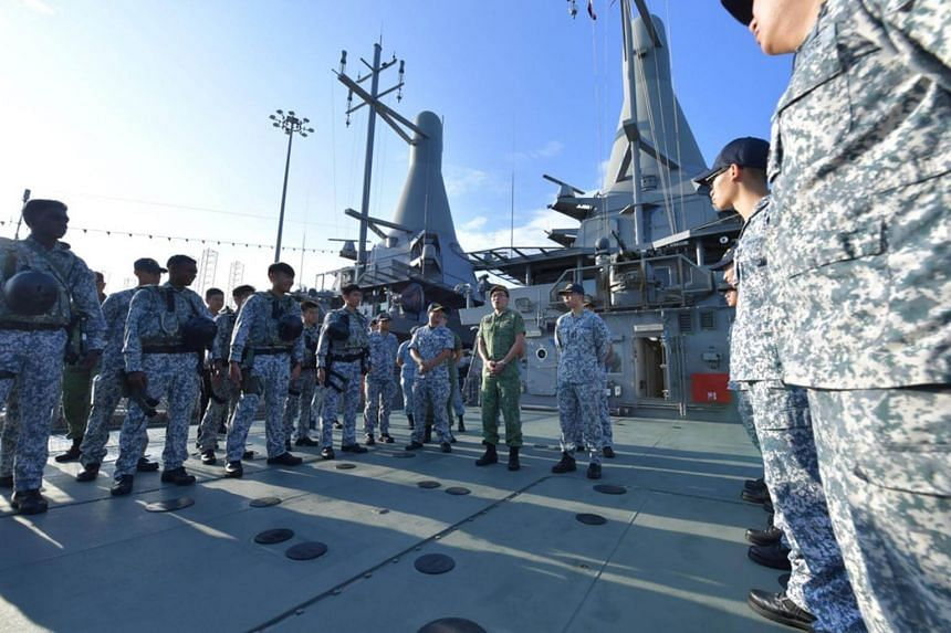 Chief of Defence Force Melvyn Ong with the crew from the Republic of Singapore Navy Littoral Mission Vessel, RSS Justice, and members from the Accompanying Sea Security Team, as part of his visit to the Maritime Security Task Force at Tuas Naval Base