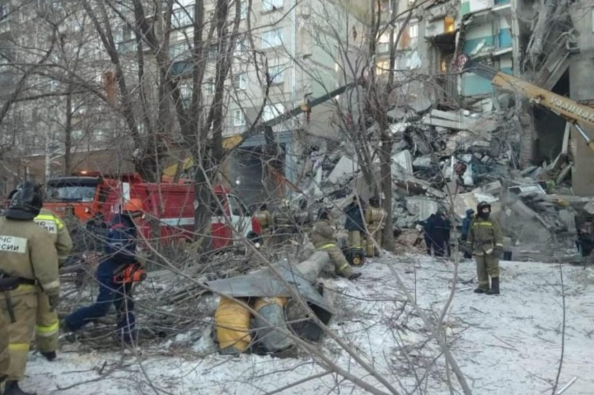 Emergency personnel at the site of a collapsed apartment building, after a suspected gas blast in Magnitogorsk, Russia, on Dec 31, 2018.