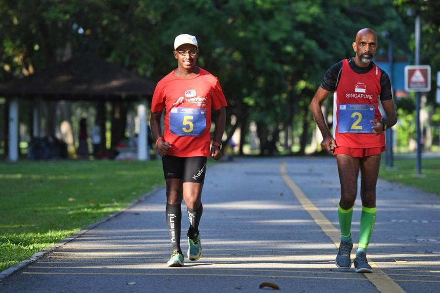 Mr G. Suresh Kumar (left) and Mr R. Subramaniam are the final two of eight walkers who originally embarked on the full 200km route, which begins and ends at East Coast Park.