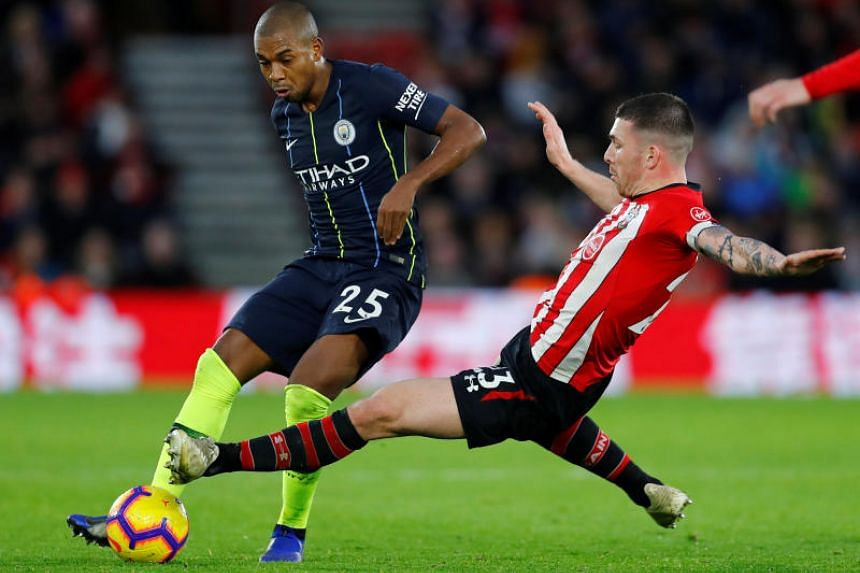 Southampton's Pierre-Emile Hojbjerg fouls Manchester City's Fernandinho leading to a red card.