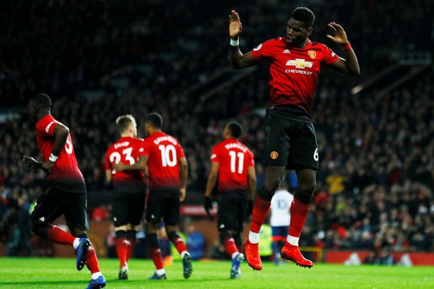 Manchester United's Paul Pogba celebrates scoring their first goal.