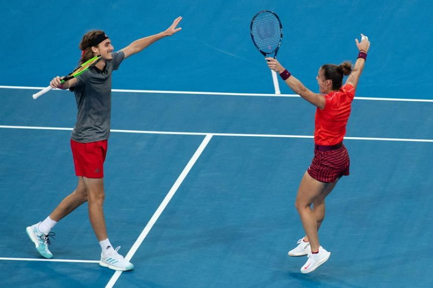 Maria Sakkari and Stefanos Tsitsipas of Greece celebrate after winning the Hopman Cup mixed doubles match against Serena Williams and Frances Tiafoe of the US in Perth on Dec 31, 2018.