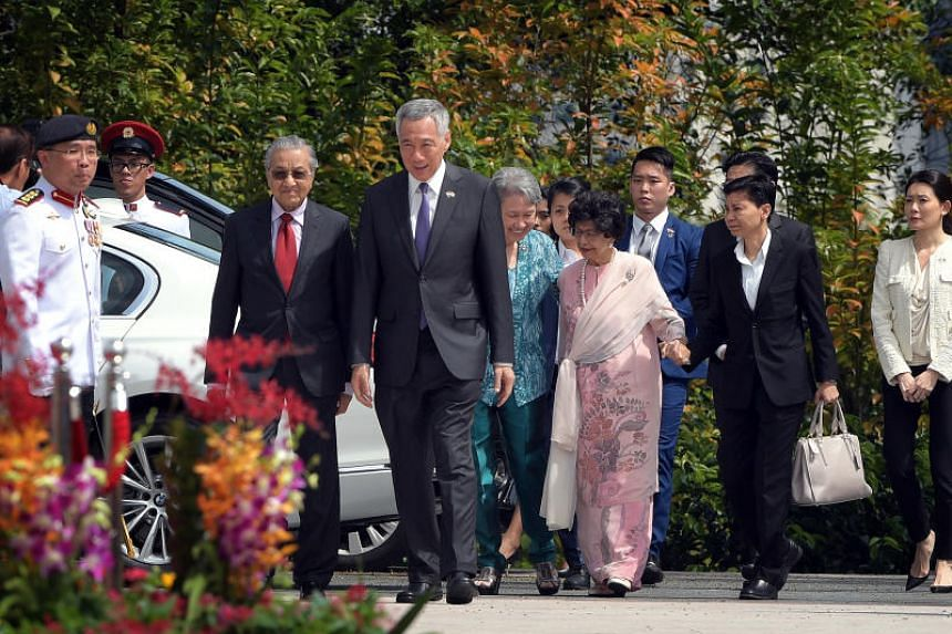 Malaysian Prime Minister Mahathir Mohamad and his wife Siti Hasmah Mohamad Ali being accompanied by Prime Minister Lee Hsien Loong and Mrs Lee on their arrival at the Istana during his visit to Singapore on Nov 12, 2018.