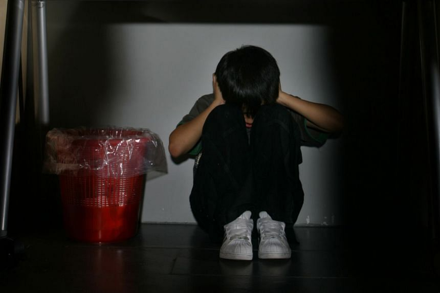 Posed photo of a child abuse victim. Last week, a panel from Japan's Ministry of Health, Labour and Welfare finalised draft measures that will form the basis for revising the Child Welfare Act.