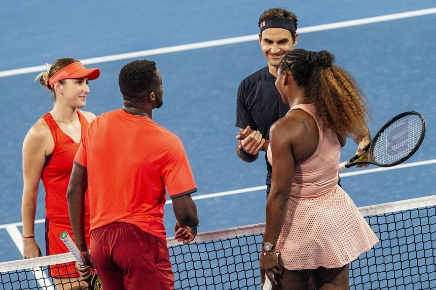 Roger Federer and Belinda Bencic of Switzerland celebrate their win with Frances Tiafoe and Serena Williams of the US.