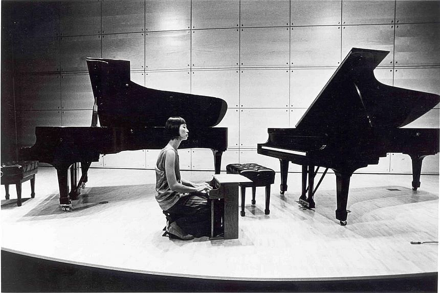 The two musicians holding concerts using the toy piano are Singapore-born Margaret Leng Tan (above, in a 1993 performance) and Singaporean musician Gu Wei (left).