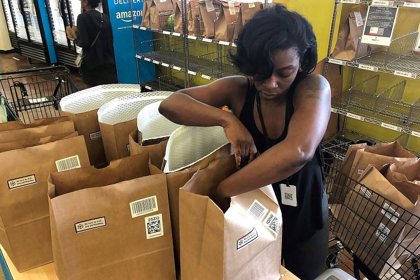 An employee packing a Whole Foods delivery order at a store in Cincinnati. Amazon.com is reportedly expanding the reach of its two-hour delivery service to nearly all of its roughly 475 stores in the United States, as well as other places where it cu