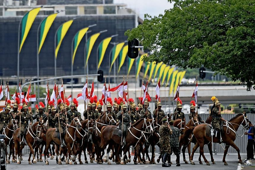 Ceremonial guards preparing for the inauguration of Mr Jair Bolsonaro as Brazil's President in Brasilia today. More than 3,000 uniformed security personnel will be stationed around the ceremony area.