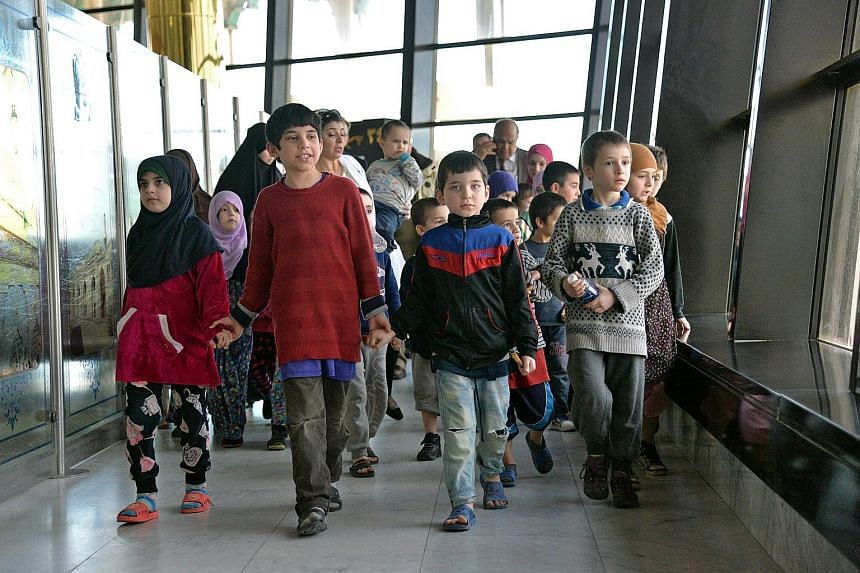 Russian children whose mothers are in prison in Iraq for belonging to ISIS about to leave Baghdad International Airport on Sunday for their home country. The children, aged three to 10, were taken to hospital on arrival in Russia for thorough examina